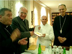 Fr. Dominic Santamaria (center) with the award